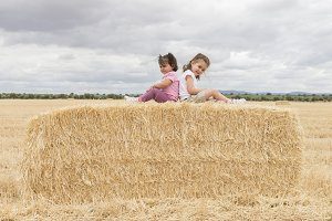 Girls in straw field