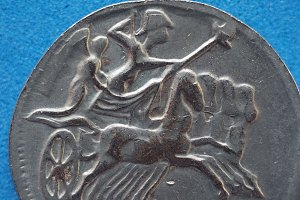 ancient roman coin with horses and b