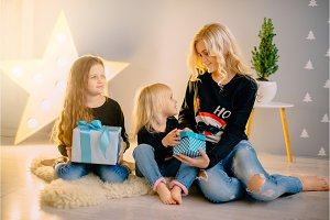 young mother gives gifts to her