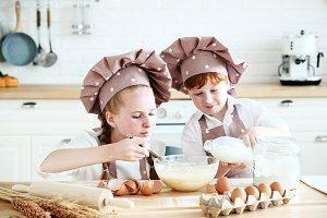 Chef kids having fun in the kitchen