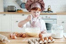 Child preparing the dough