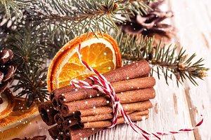 Cinnamon sticks and dry oranges on a