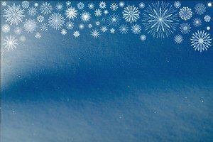 Snowflakes pattern on shiny snow