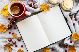 autumn flat lay with notebook, cup o