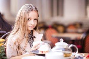 Baby girl in cafe
