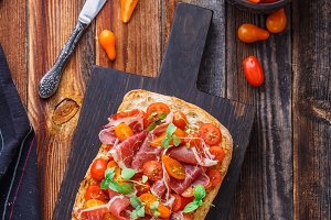 Grilled bread with jamon and cherry