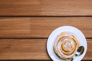 Cinnamon bun on a white plate