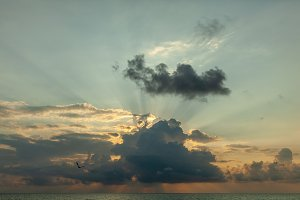 Sunset with clouds, light rays and o