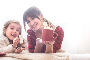 Mom and little cute daughter eating