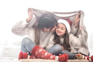 Christmas concept, mom and girl