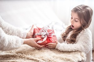 Christmas concept, Mom gives a gift