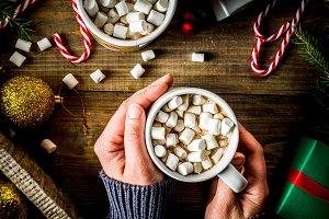 Girl drinks hot chocolate with marsh