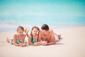 Father and kids enjoying beach summe