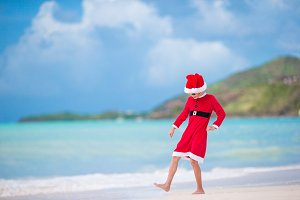 Adorable little girl in Santa hat on