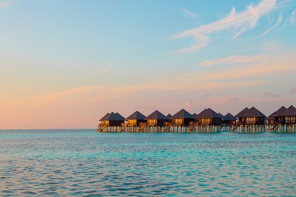 Water bungalows and wooden jetty on…