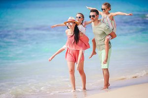 Young family on vacation on the beac