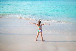Cute little girl on the beach during