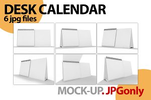Empty desk calendar on table. Mockup