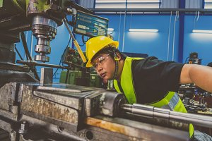Asian machinist in safety suit opera