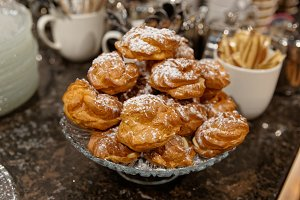 Cream puffs on bakery display