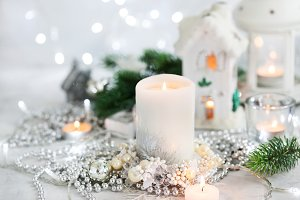 White candle on holiday silver backg