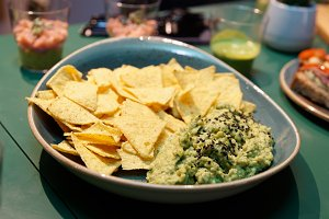 Guacamole dip sauce and nachos chips
