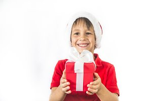 Child boy in christmas Santa hat and