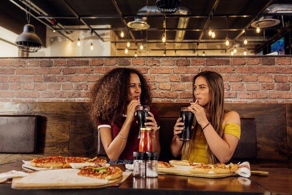Best friends drinking cola