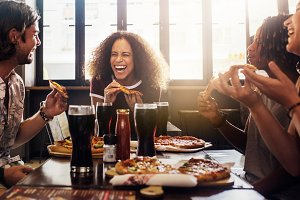 Friends enjoying while having food