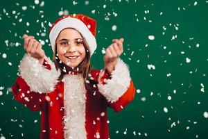 Girl in santa claus dress enjoying