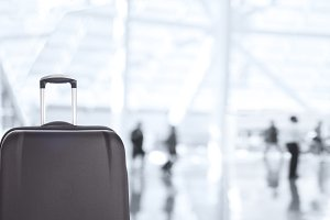 Luggage Closeup with Blurred Travele