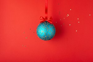 Christmas ball hanging on red ribbon