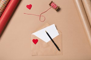 Craft envelope with red heart, blank