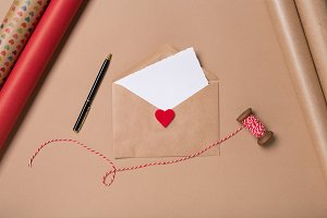 Craft envelope with blank paper, pen