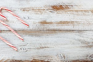 Christmas candy canes on rustic wood