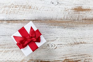 Christmas gift box on rustic wood