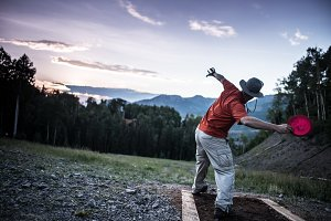 Man Playing Disc Golf in Mountains