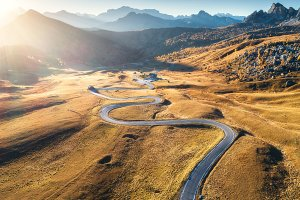 Winding road in mountain valley