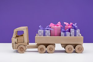 Toy car with gifts in boxes.