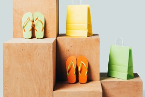 colored paper bags and flip flops on