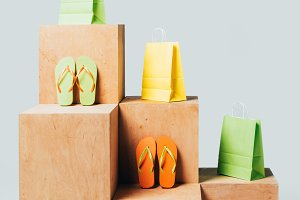 colored shopping bags and flip flops