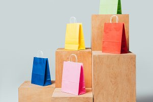 blue, yellow and green shopping bags