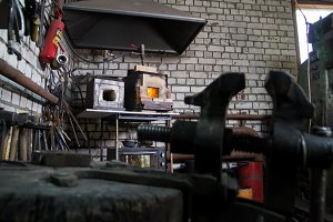 Workspace of blacksmith. Furnace in