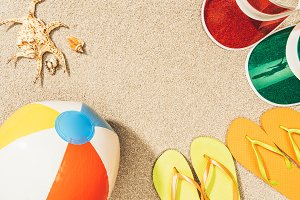 flat lay with colorful flip flops, b