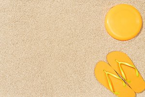 top view of yellow flip flops and fr