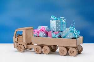 Wooden toy truck with gifts