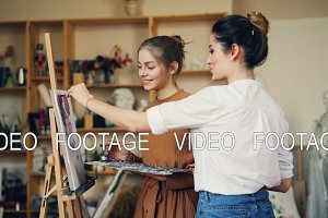 Young women art teacher and student