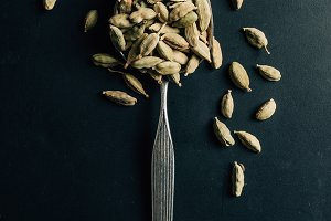 top view of cardamom seeds on spoon
