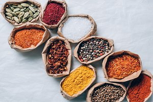 top view of colorful spices in paper