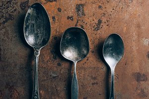 elevated view of three silver spoons